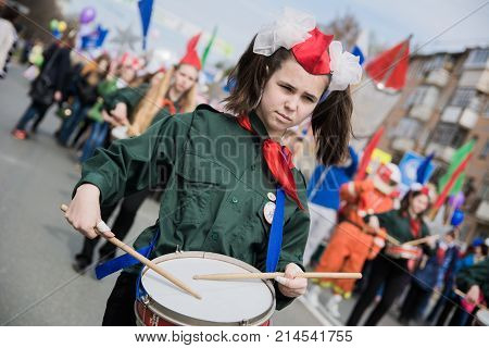 Yoshkar-Ola Russia - May 1 2016 Girl pioneer playing the drum during the march on the May Day demonstration in Yoshkar-Ola Russia