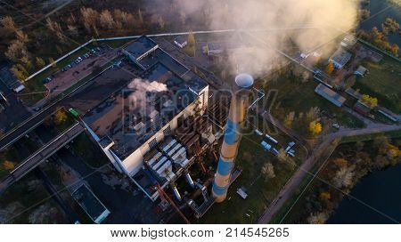 Garbage incineration plant. Waste incinerator plant with smoking smokestack. The problem of environmental pollution by factories