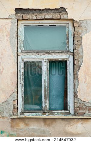 old wooden window on the dilapidated wall