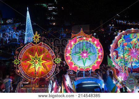 SAKON NAKHON, THAILAND - DEC 25, 2015 :The celebrating Christmas with the dazzling star parade on more than 200 cars together with a Santa Claus and angels parade in Parade of Christmas Star Festival.