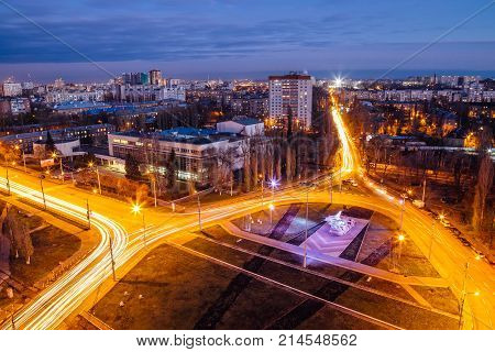 Night Voronezh, aerial view to road junction ring near airplane memorial in south-west district