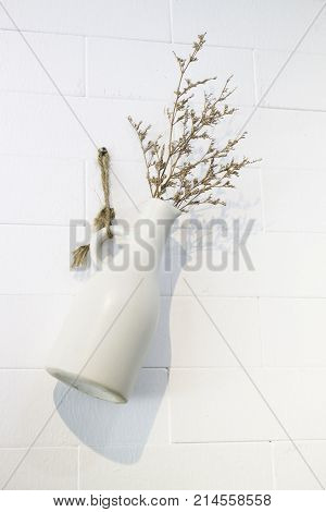 Dried little white flowers in vase stock photo