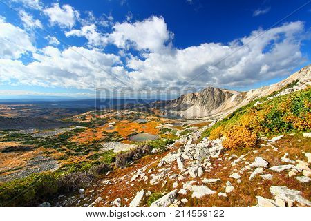 Sunlight shines along the eastern face of Medicine Bow Peak in the national forests of Wyoming