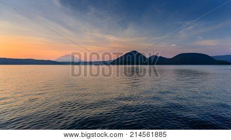Scene of mountain and lake at twilight in Hokkaido Japan.