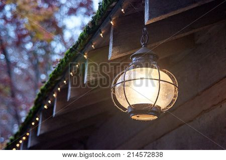 Round Globe light hanging from side of roof