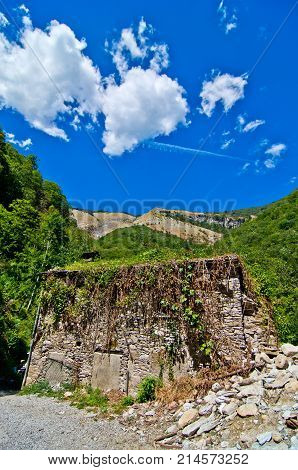 Ruined Stone Building In The Mountains With Blue Sky