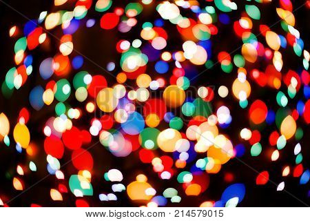 Color light blurred background, unfocused. Christmas or other holiday decorations, garland illumination bokeh.