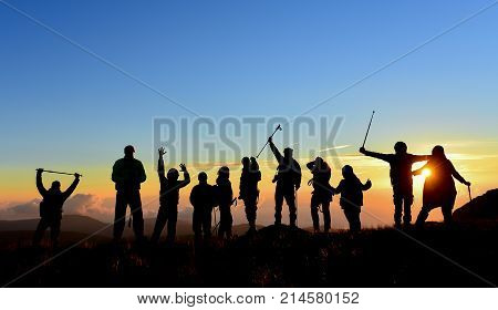 enthusiastic successful and enthusiastic marching group & trekking & hiking & outdoor sports & success group