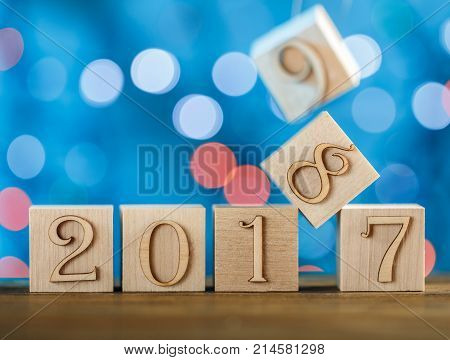 The arrival of the new year 2017-2018 and in the background 2019. The chronology of years. Creative idea. On a blue background.