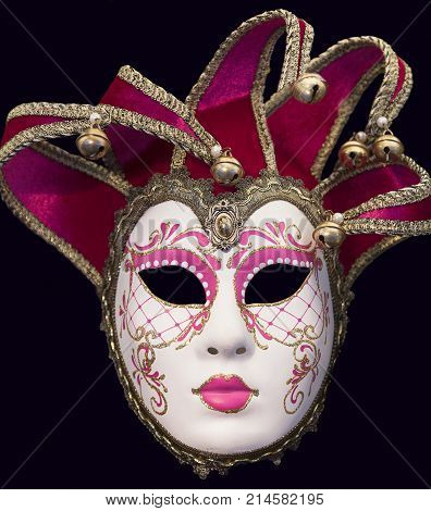 Original venetian mask isolated on black background. The Venetian carnival tradition is most famous for its distinctive masks