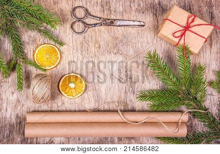 Preparation for Christmas and gift wrapping. Christmas background. Fir tree packing paper and scissors.