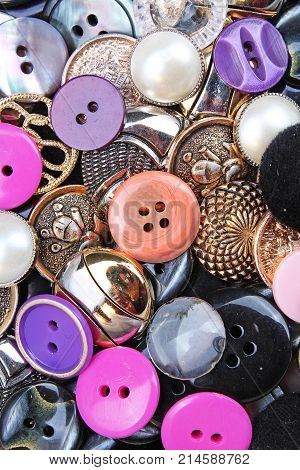 Buttons background. Colored shiny clothing button texture. Colored sewing buttons pattern concept wallpaper. Mixed colors. Studio photo texture photography. Colorful.
