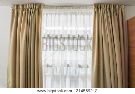 close up luxury curtain at window in house