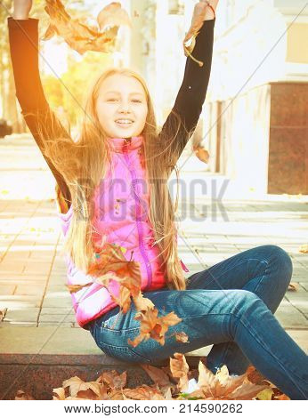 Portrait Of A Beautiful Girl In Autumn Leaves,  September The Beginning Of The School Year