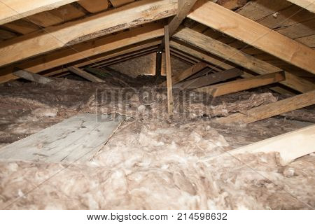 Mineral wool stack on construction site - thermal insulation of a house Soft eco-friendly insulation for the roof is safe for the hands skin