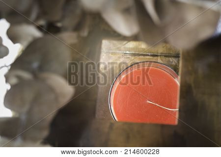Red aroma candle in wooden box stock photo