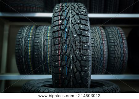 Winter Tire On The Background Of Racks With Tires