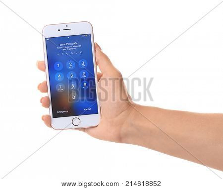 KIEV, UKRAINE - OCTOBER 06, 2017: Woman holding Rose Gold iPhone 6S with numpad for entering the passcode on screen, isolated on white