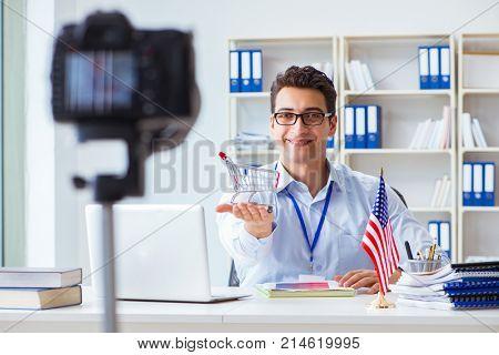 Businessman explaining online shopping in video blog