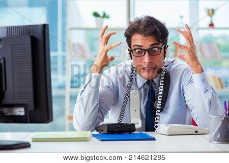 Unhappy angry call center worker frustrated with workload