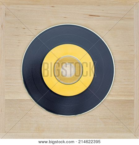 Black and yellow cd looks like vinyl on the wooden background