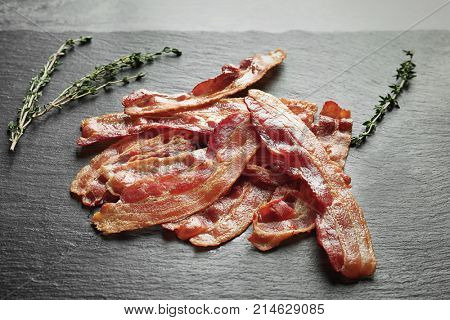 Cooked bacon rashers on slate plate
