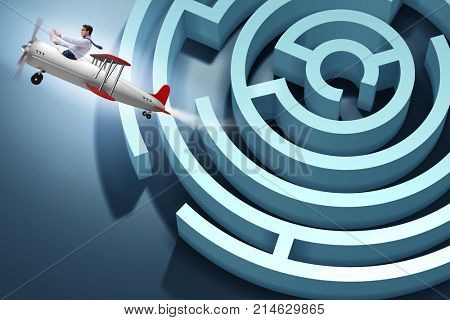 Businessman escaping from maze on airplane