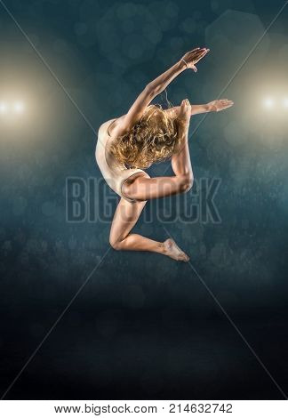 One person, gymnastic, dancer, woman in dynamic beautiful action figure under light on the sport arena.