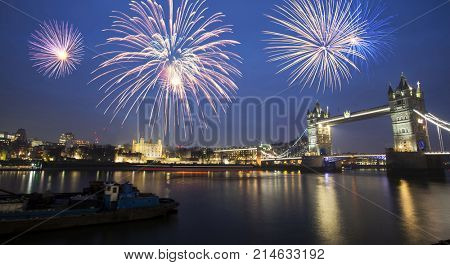 Tower Bridge with fireworks - celebration of the New Year at the the Thames river, London, United Kingdom