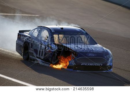 November 19, 2017 - Homestead, Florida, USA: The car of Danica Patrick (10) catches on fire during the Ford EcoBoost 400 at Homestead-Miami Speedway in Homestead, Florida.