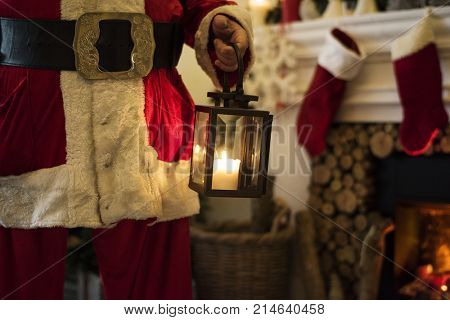 Santa claus walking inside the house at night