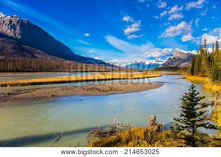 Indian summer in the mountains of Canada. Exquisite Abraham Reservoir Lake. Concept of ecological and active tourism