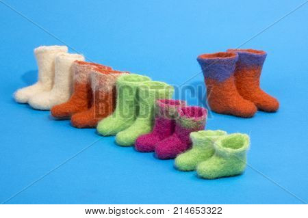 Souvenir Boots Made Of Felted Wool On A Blue Background