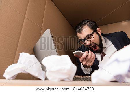 Businessman Yelling At Smartphone