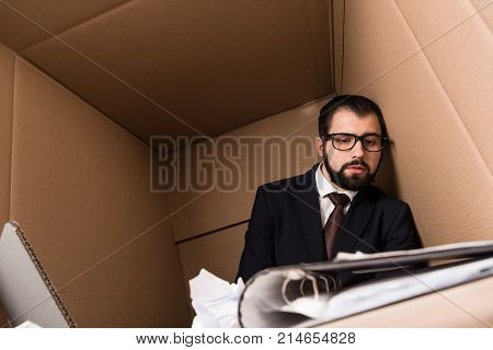 Exhausted Businessman With Paperwork