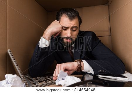 Bored Businessman Looking At Watch
