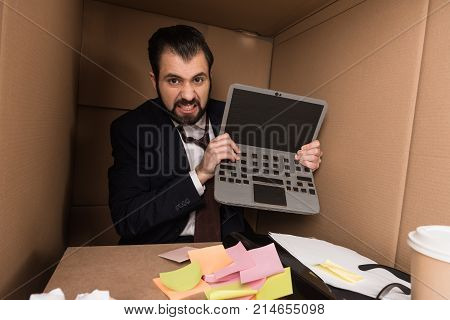 Angry Businessman With Cardboard Laptop