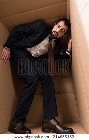 Businessman With Claustrophobia Inside A Box