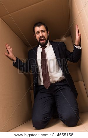 Stressed Businessman In Box