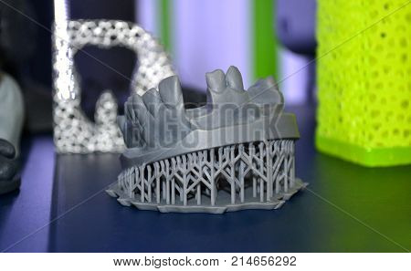 Human lower jaw printed on 3d printer of photopolymer. Stereolithography 3D printer of liquid photopolymerization under UV light. Progressive additive technology. Concept of 4.0 industrial revolution