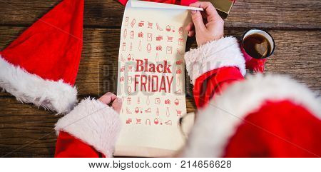 Black friday advert against santa claus reading scroll