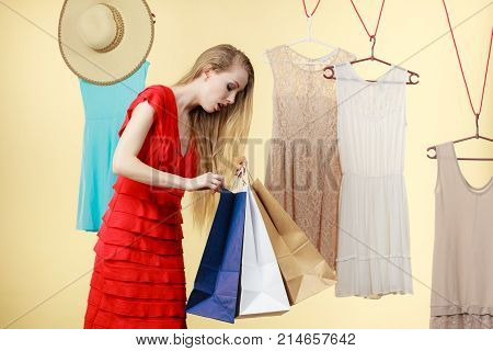 Woman In Shop Picking Clothes, Sale Concept