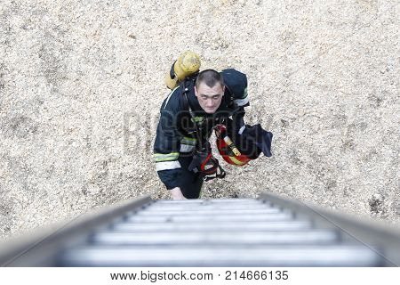 Belarus Gomel 04/06/2017 extinguishing forest fire.Belarus.Fireman will climb up the stairs.Work firefighter. Extinguish the fire. Rescue work. Exercises of rescuers.