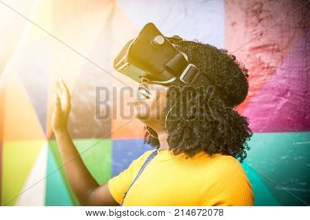 African woman wearing virtual reality goggles