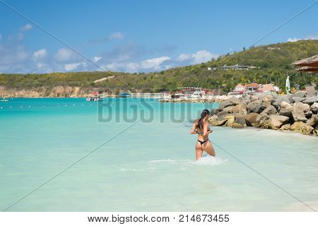 Woman In Swimsuit Walk In Sea In St Johns, Antigua