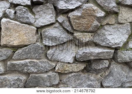Rubble grey stone wall rubble work . poster