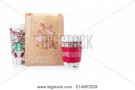Chiang Mai Thailand- 18 November 2017 - Starbucks Coffee paper cups in beautiful 2018 Christmas design and food brown bag in Give Good design display on white background in Chiang Mai Thailand on November 18 2017