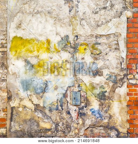 colorful painted abandoned stucco brick wall background