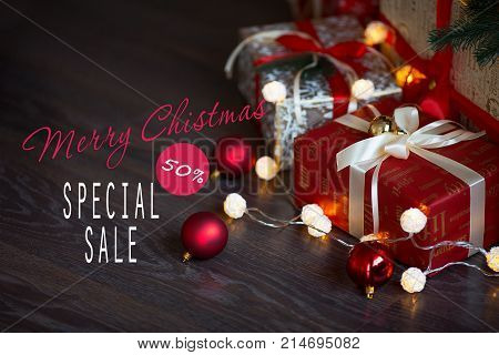 Sales on Christmas and New Year holidays. Festive decoration with informative inscription of 50 percent discount for shop-windows, shopping malls and advertizing background concept.