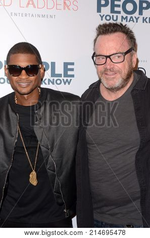 LOS ANGELES - NOV 13:  Usher Raymond IV, Tom Arnold at the